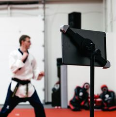 A Taekwondo instructor teaching an online class