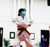 A kid training Taekwondo