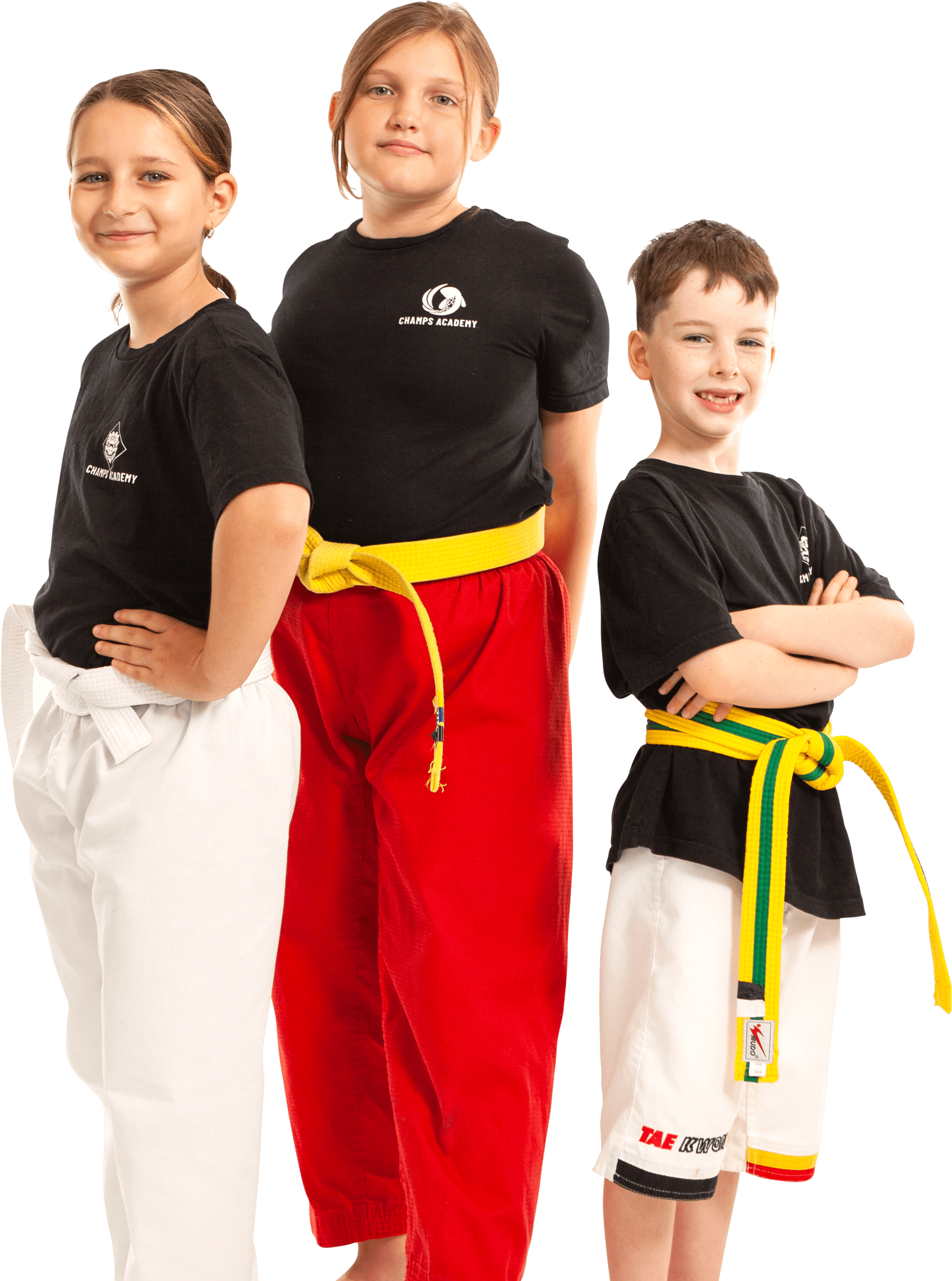 3 kids smiling in their martial arts uniforms