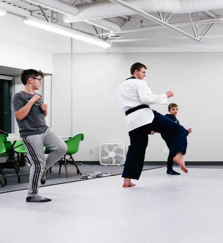 Two Teenagers Learning Taekwondo