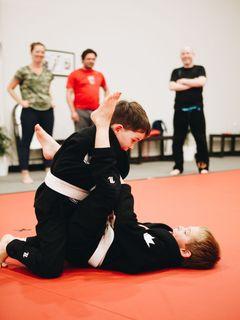 Two kids doing Brazilian Jiu Jitsu