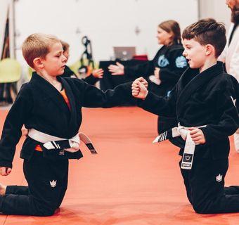 2 kids training Brazilian Jiu Jitsu