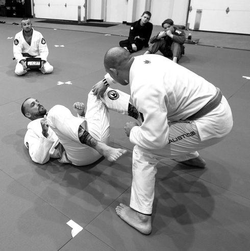 Two Adults doing Brazilian Jiu Jitsu