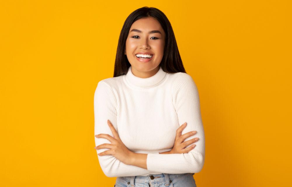 Girl happy with orange background