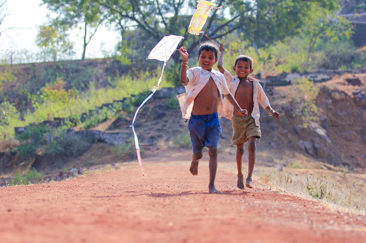 Two children playing with their kites