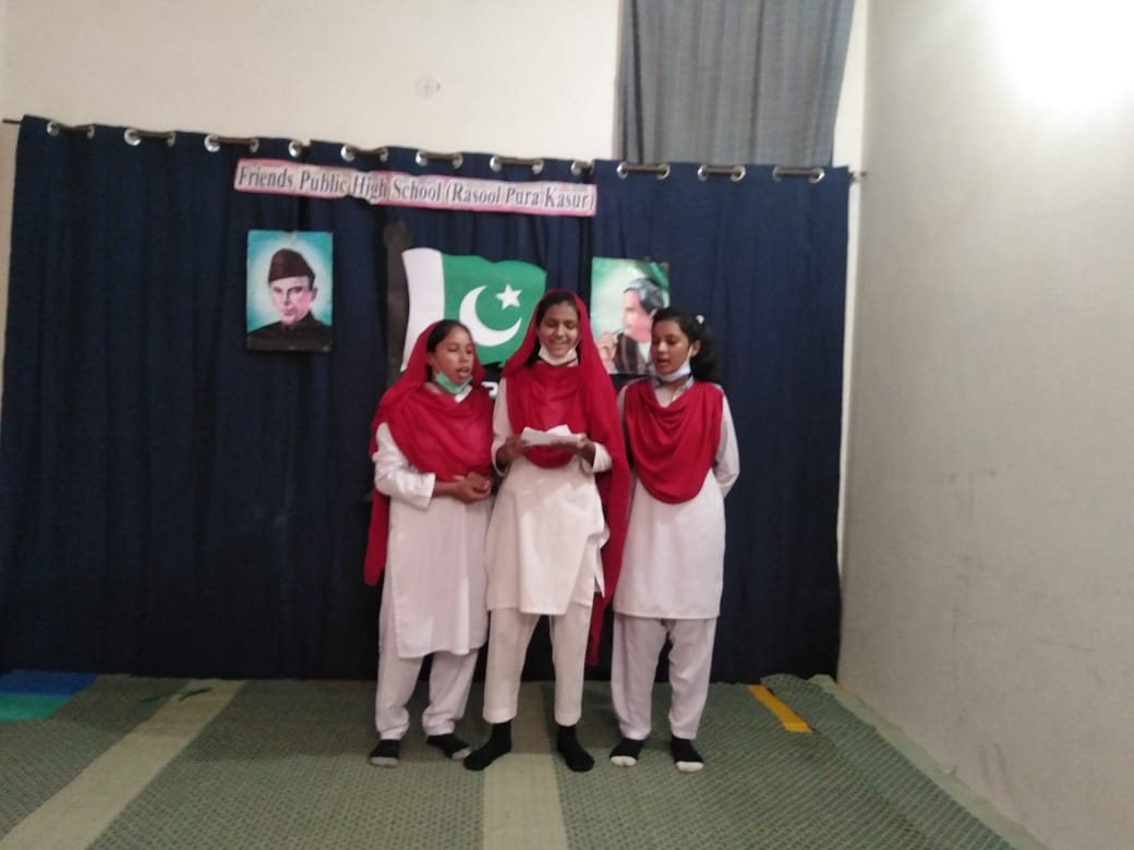 Three students presenting a song