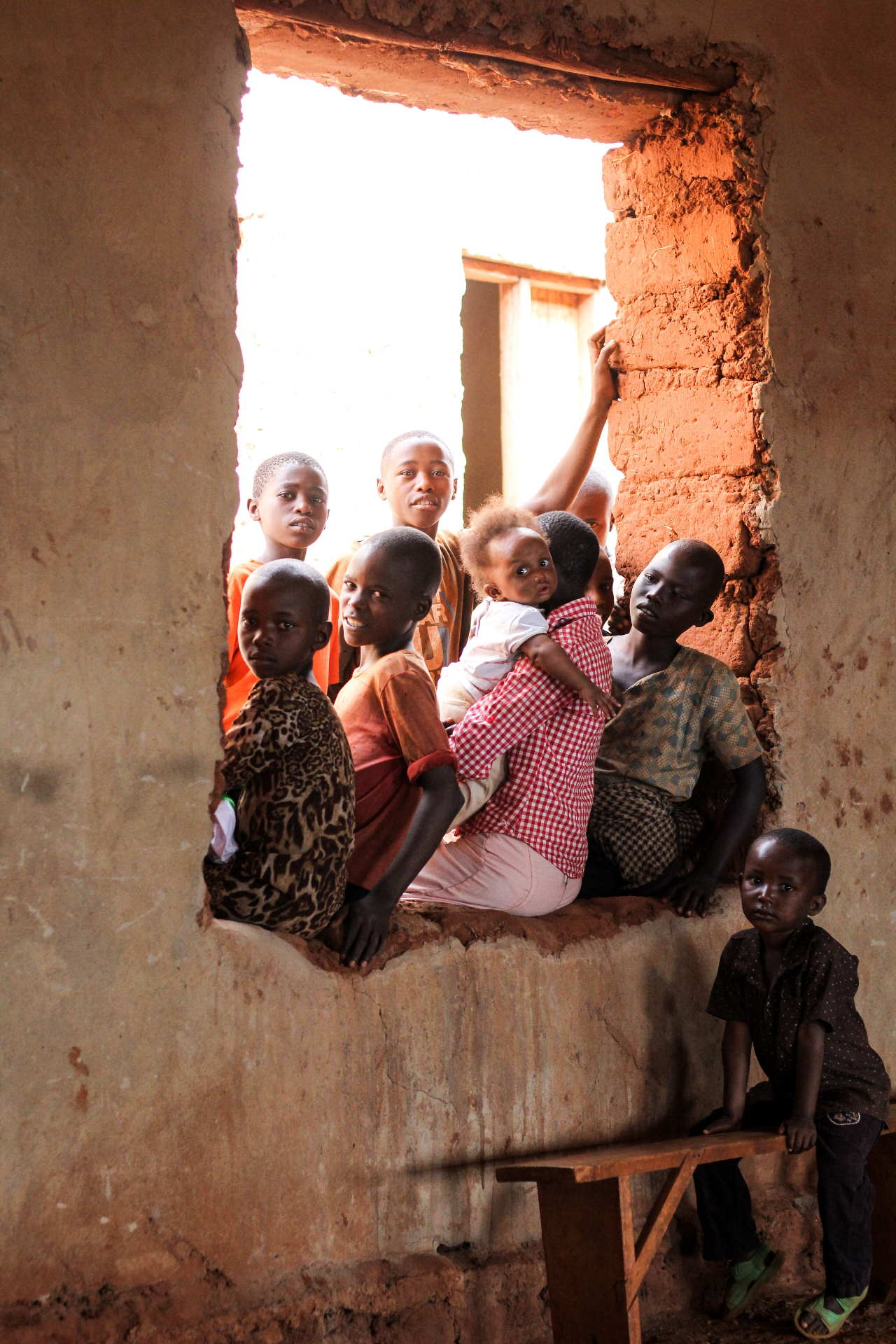 A group of children sitting at a large window