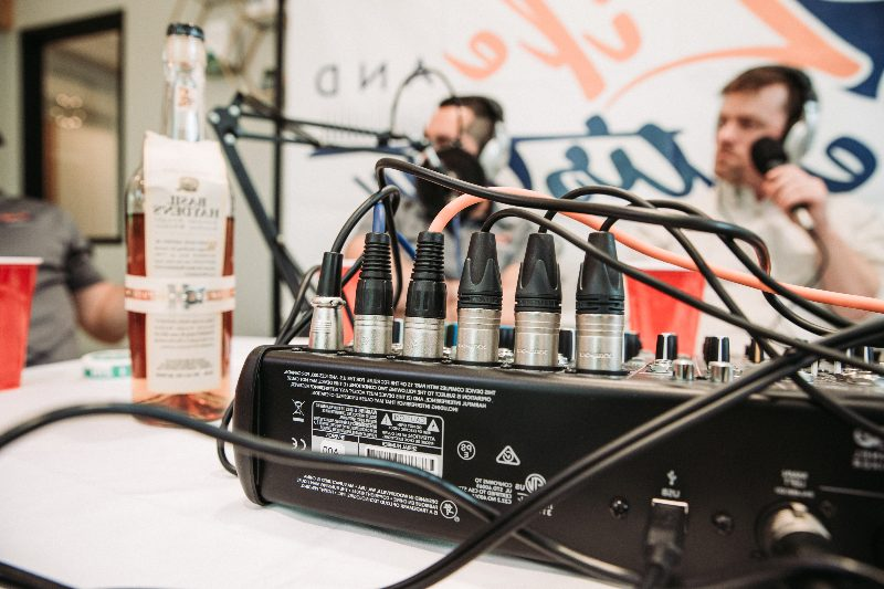 podcasting equipment and whiskey bottle