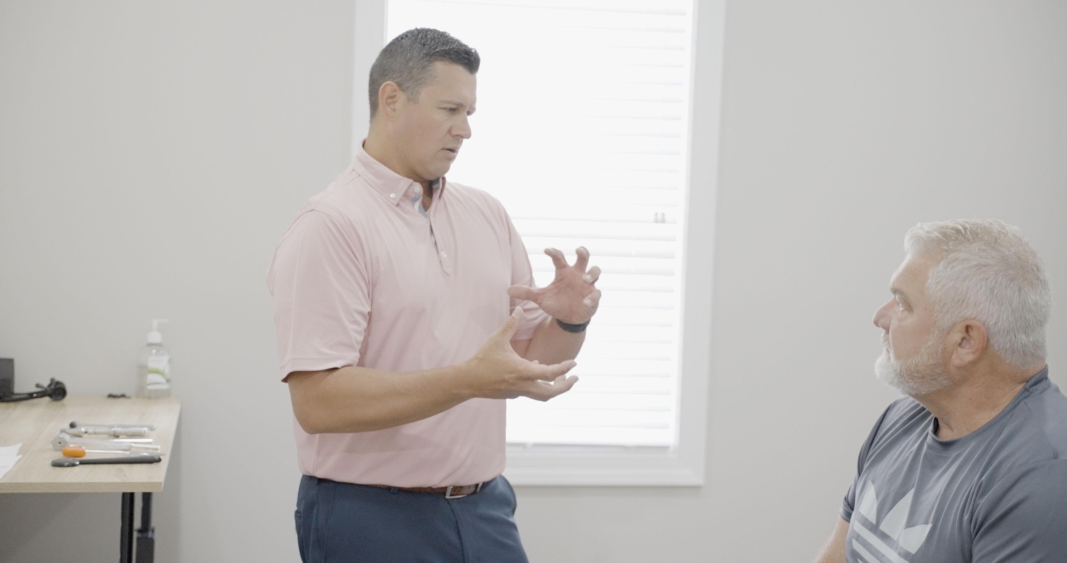 Dr. Paul explaining to the patient