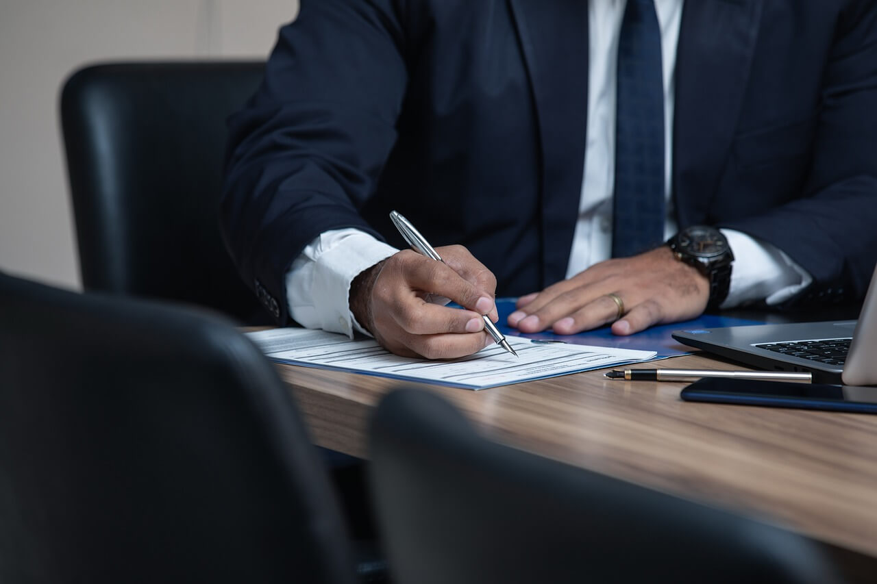 A businessman filling in documents