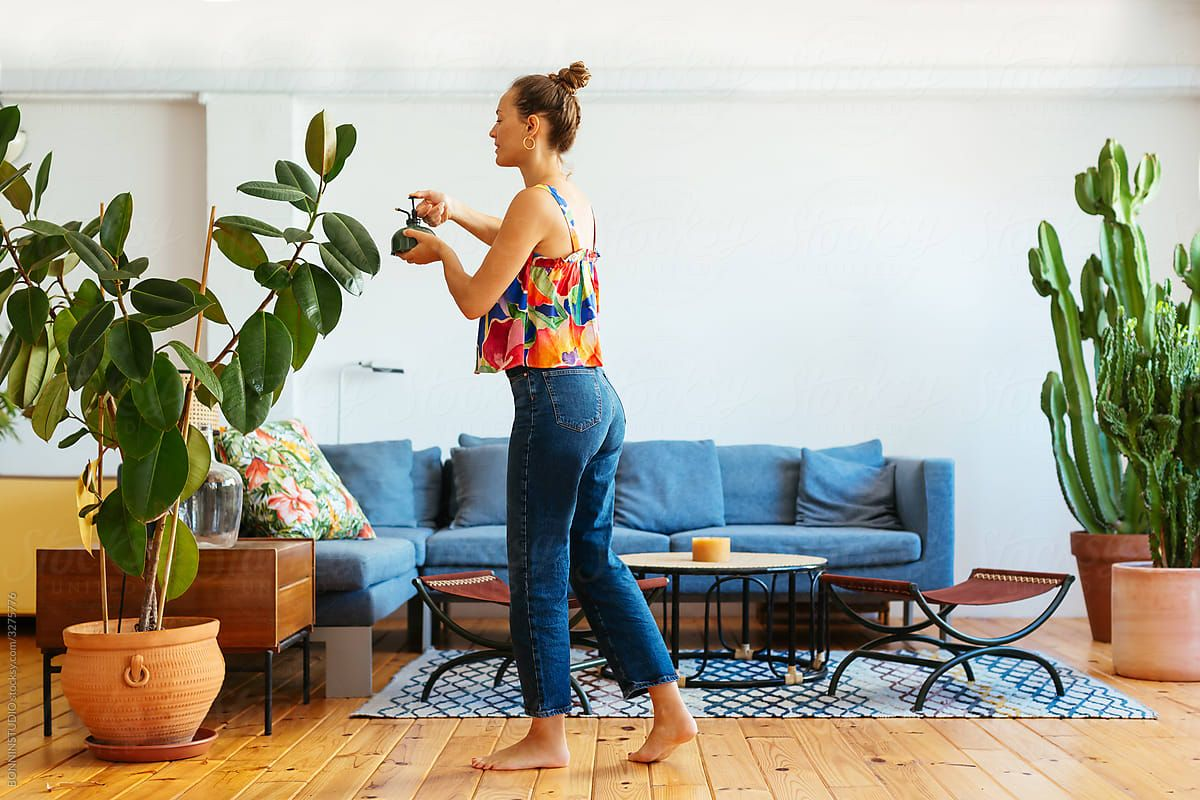 Woman cleaning in her living room