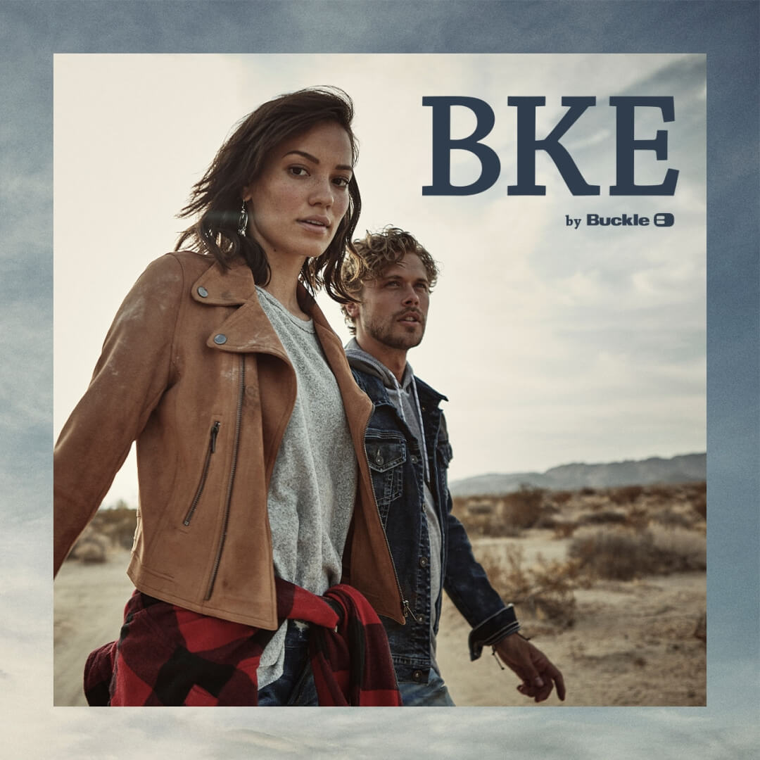 Young womman and man wearing BKE by Buckle apparel in a desert