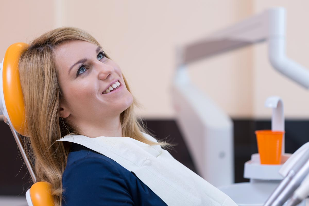 Lady about to receive a root canal in Wellington, FL.