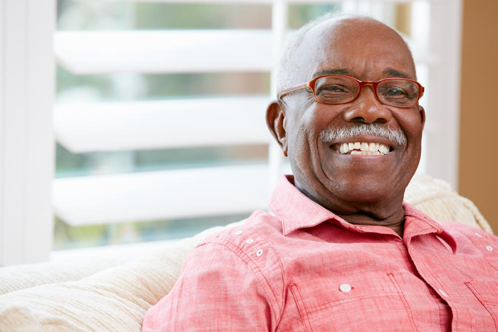 Elderly man smiling after receiving dentures in Wellington, FL.