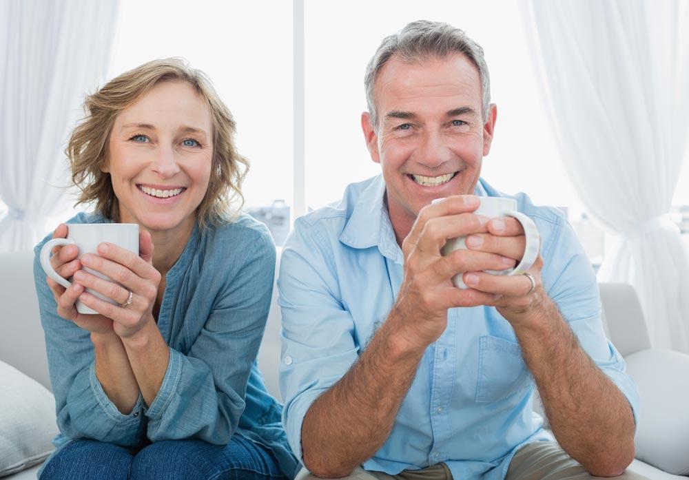 Elderly couple smiling after receiving veneers in West Palm Beach, FL.