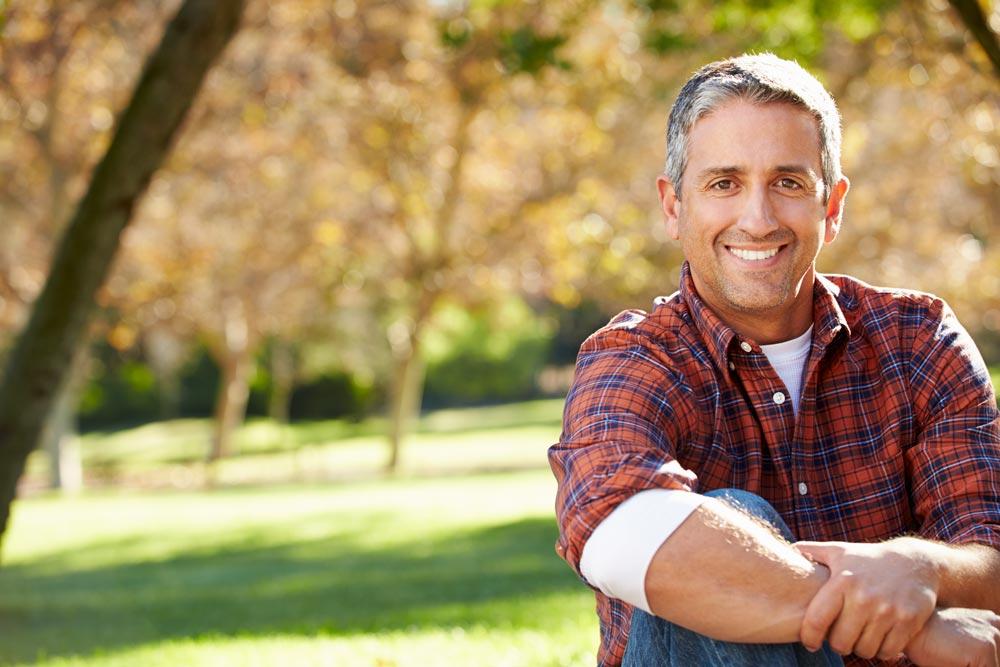 Middle aged man smiling after receiving dental implants in Wellington, FL!
