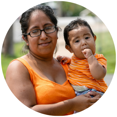 a hispanic mother holding her toddler son