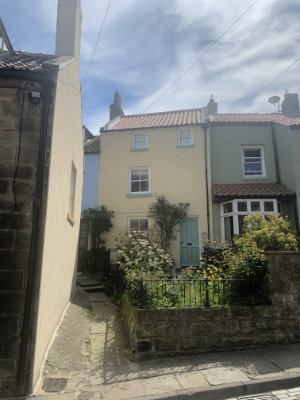 A picture of the front of Confidence Cottage in Staithes.