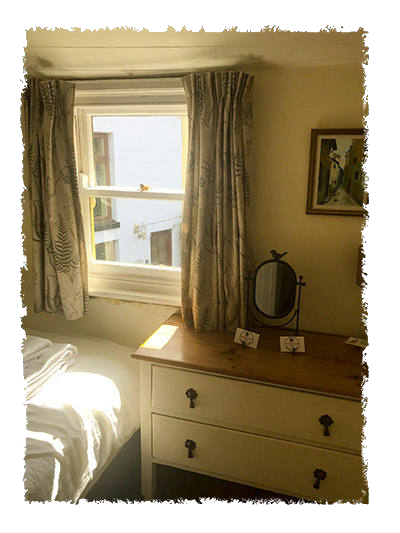 A view of the bedroom in Glaisdale Cottage, Staithes.