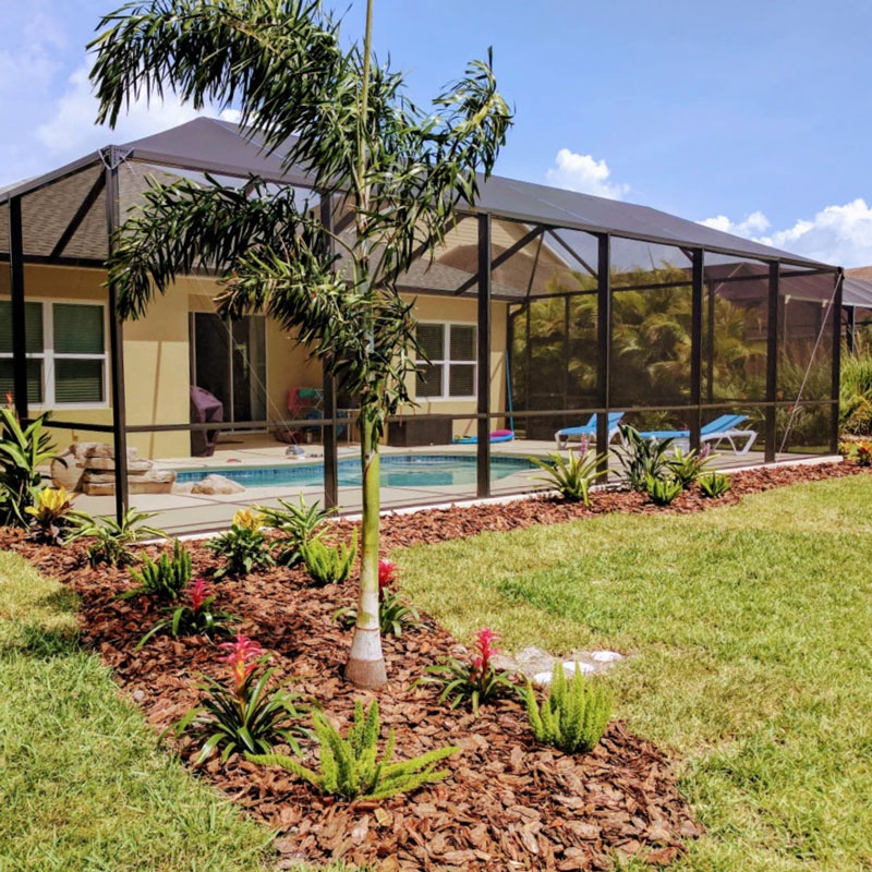 A pool area complemented by a beautiful landscape in Parrish, Fl.