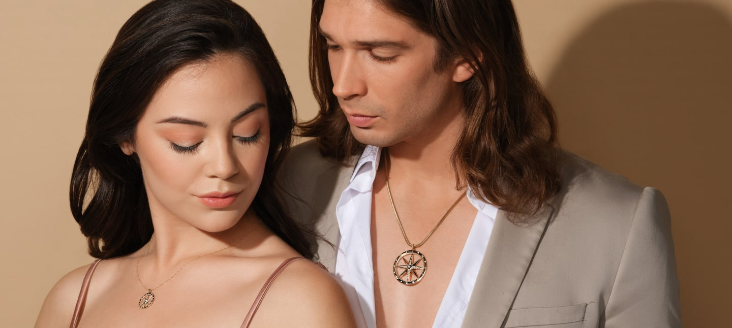 cropped shot of a couple wearing pendant necklaces