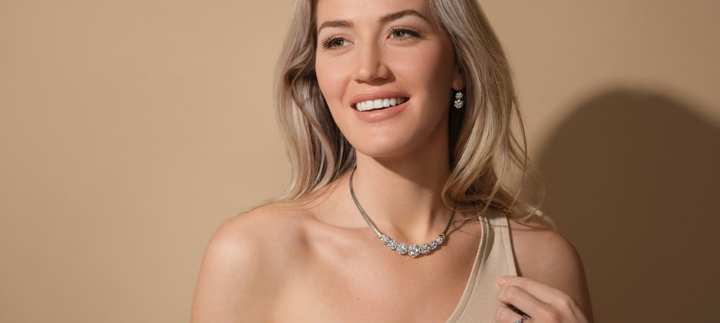 cropped photo showing a necklace with many diamonds