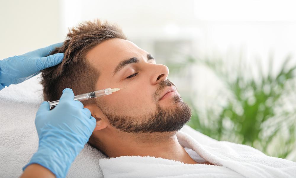 Male receiving Botox treatment