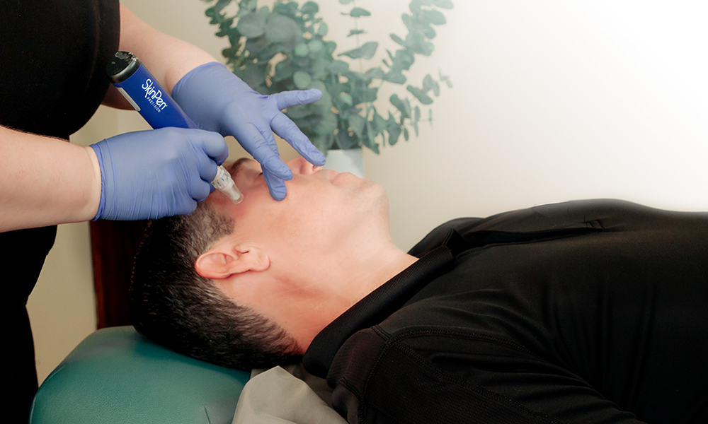 Male receiving Microneedling with the SkinPen at SkinReMEDI by Natural Body Spa