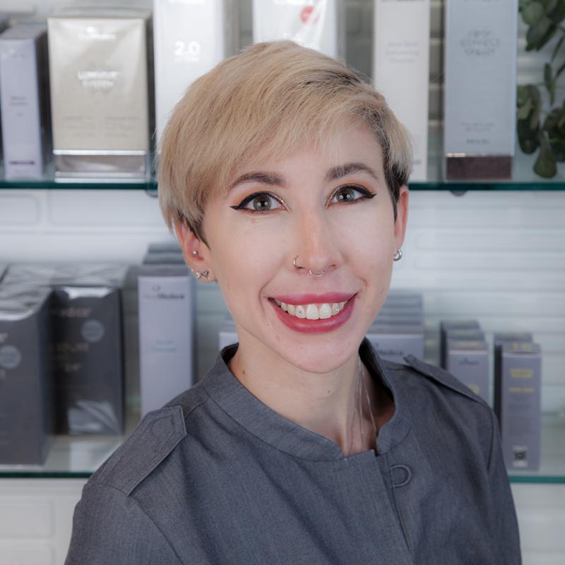 Katelyn Brown headshot in front of SkinReMEDI retail area