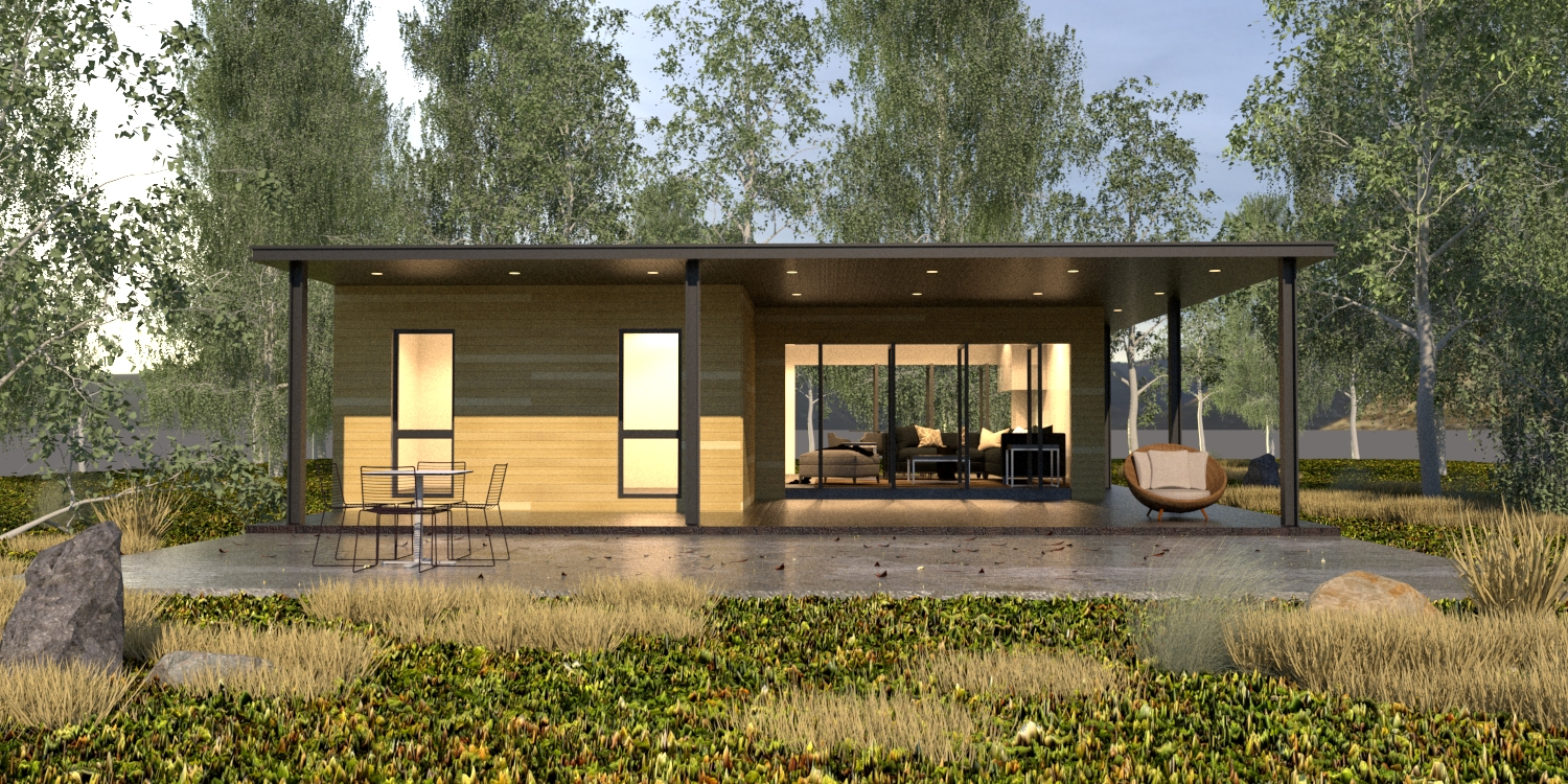 A large, rectangular modular home situated in a field, illuminated from the inside, with trees and a body of water visible in the background.