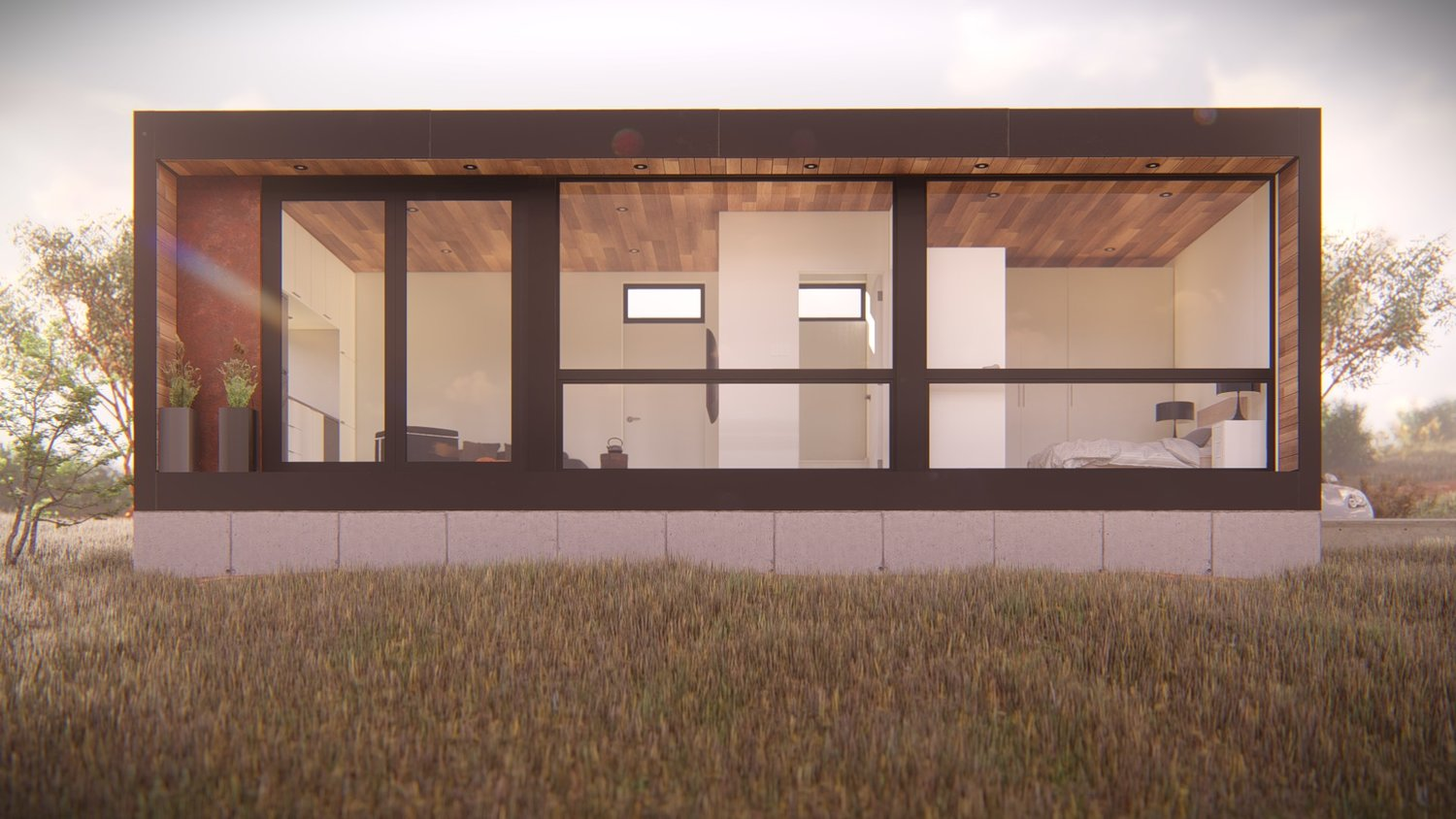 A dark brown cladded modular home on top of a hill in the daytime.
