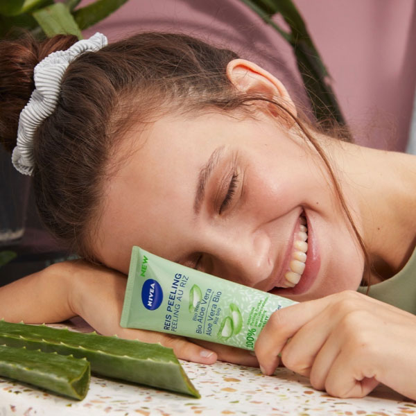 Influencer holding sponsored skin care product