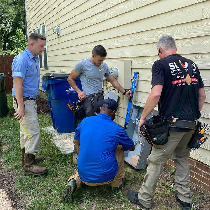Sloan Service Company team planning HVAC service