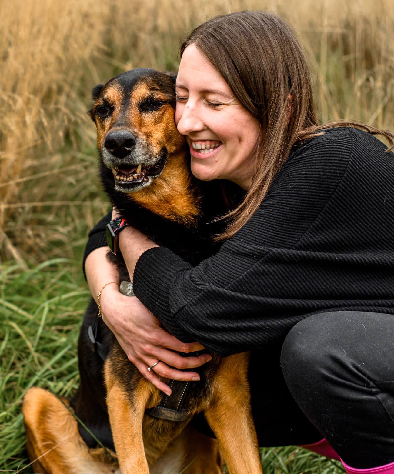Lauren hugging her dog