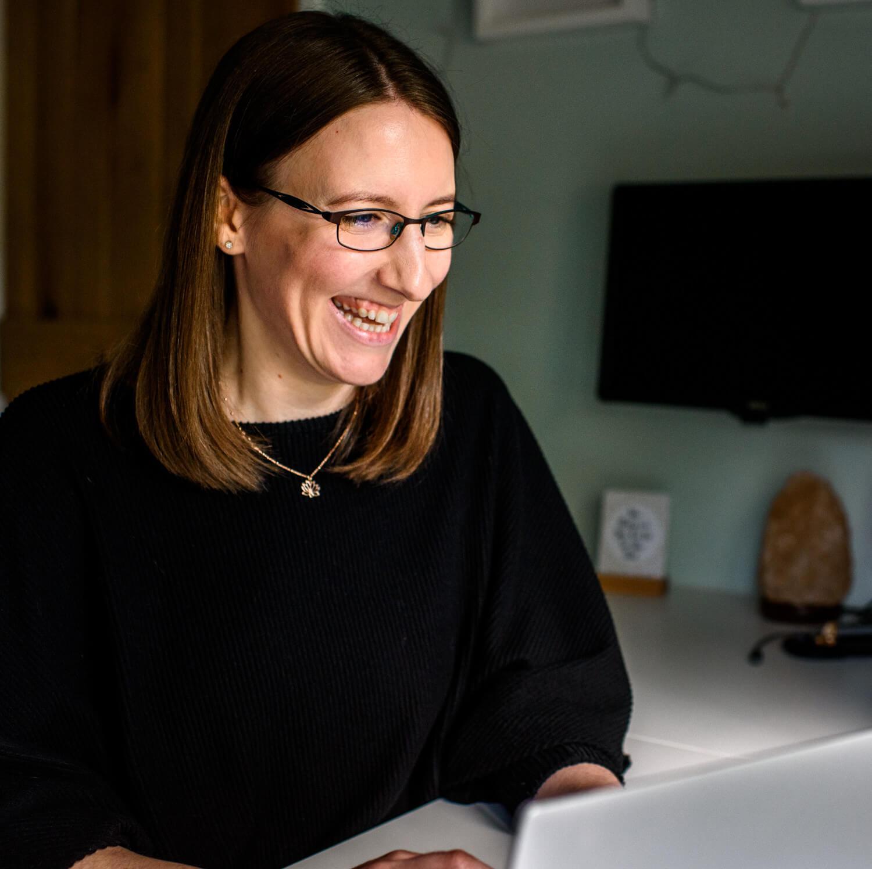 Lauren typing on her laptop