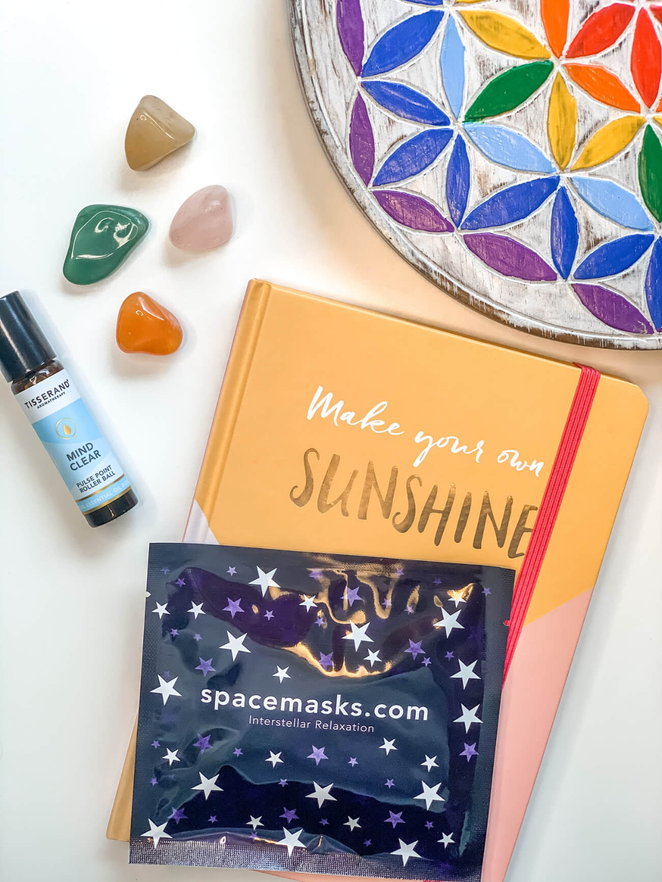 Notebook and color stones on a desktop
