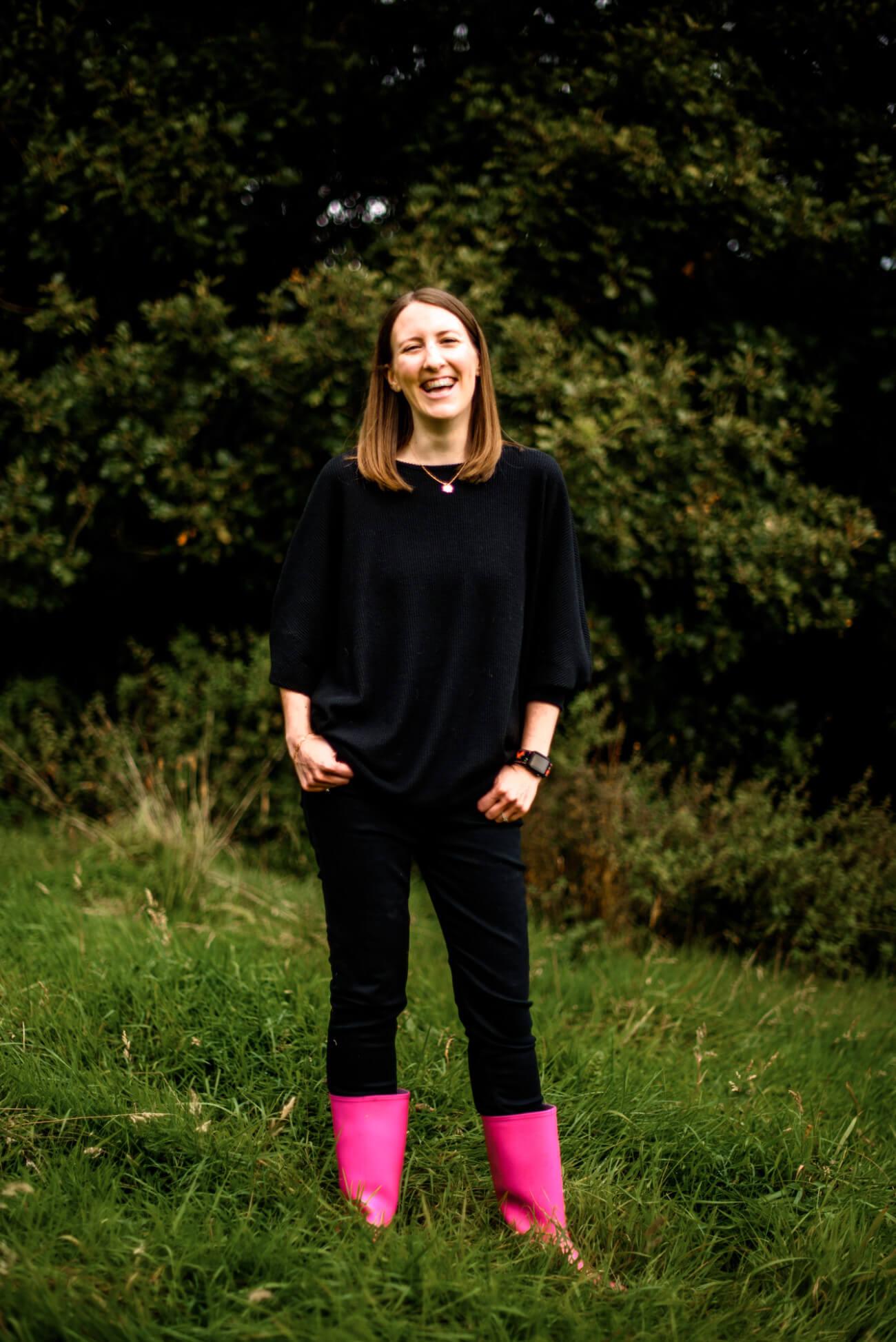 Lauren wearing pink boots outdoor