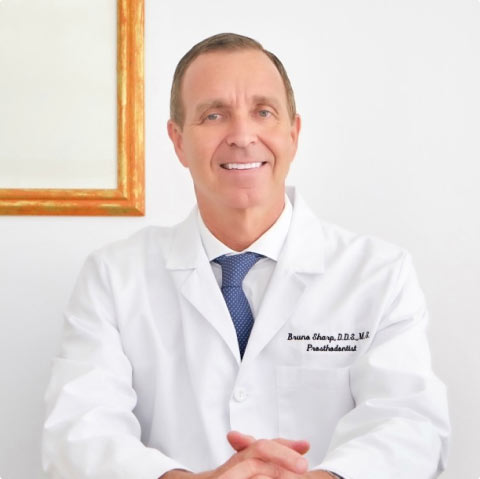 Photo of Dr. Sharp sitting at his office