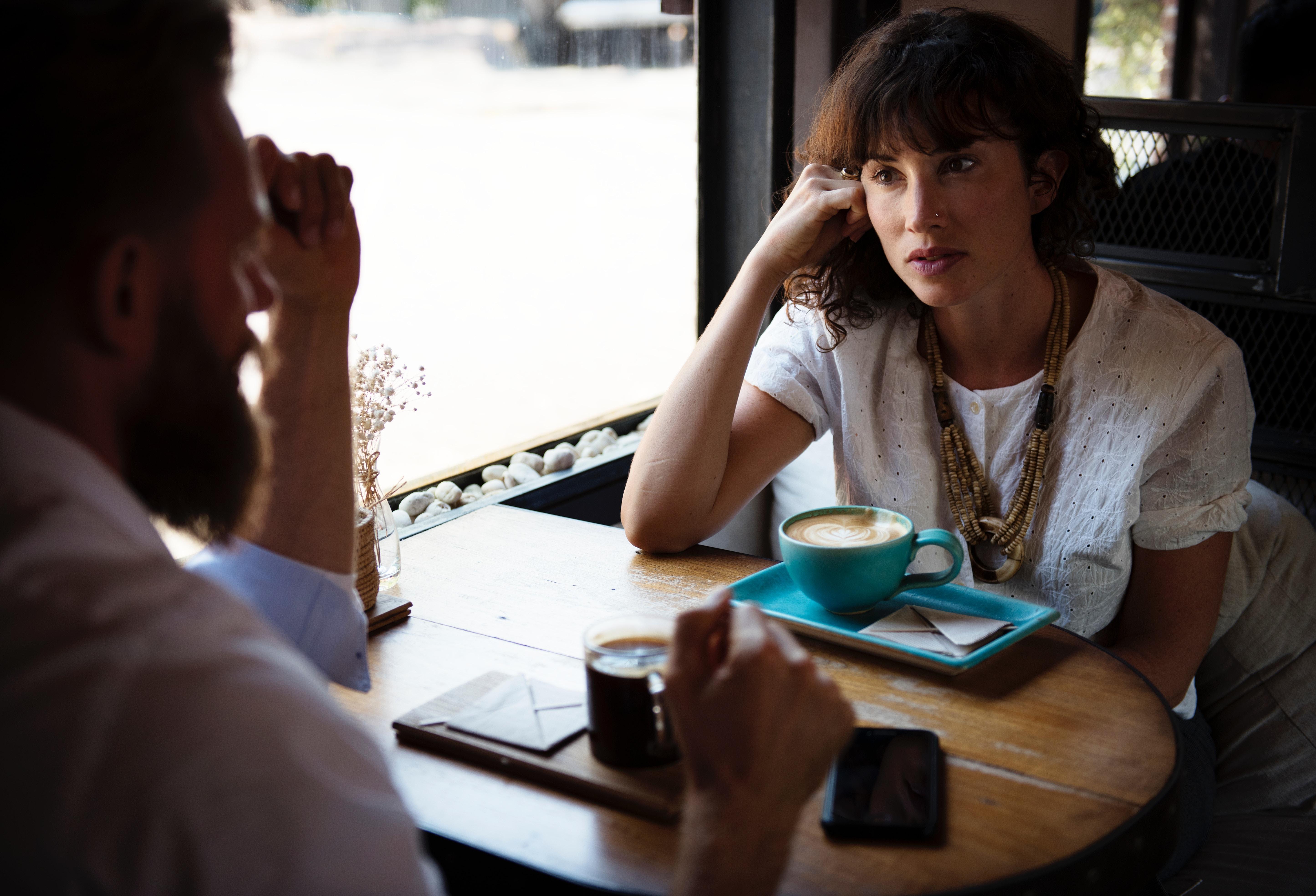Two people having coffee