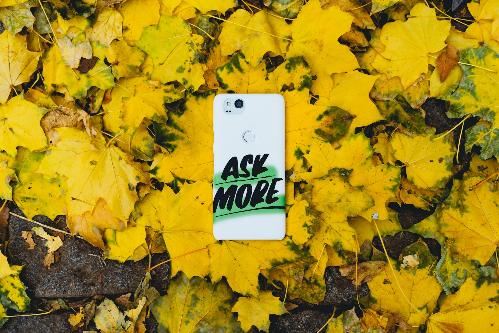 Phone case with the words 'Ask More' written on it