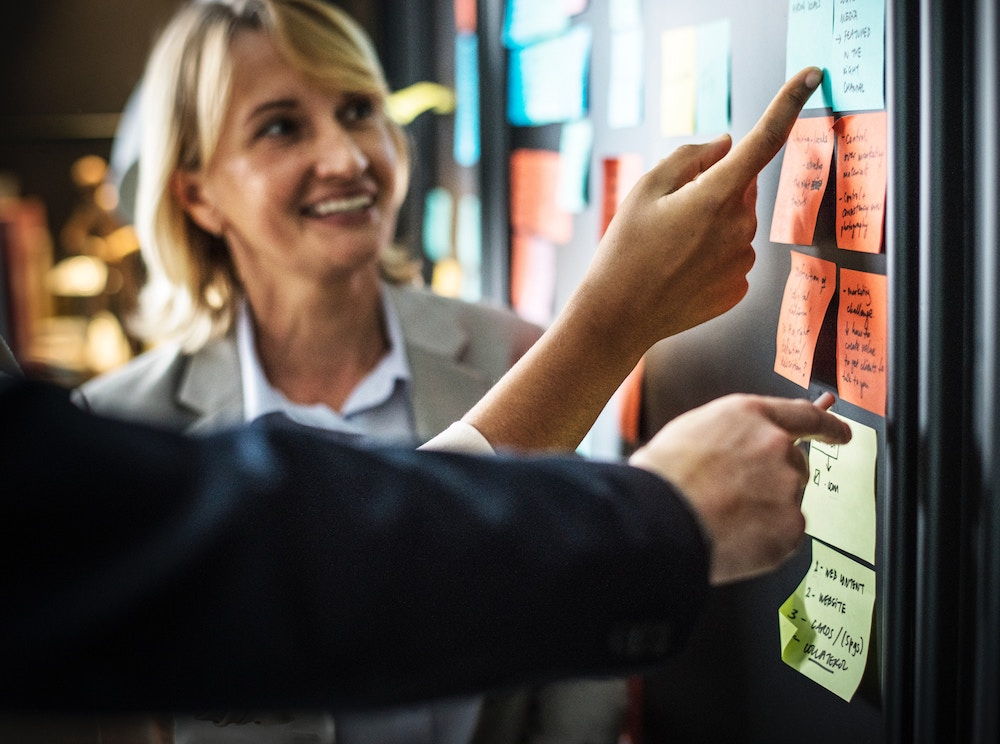 Employees collaborating with post-it notes