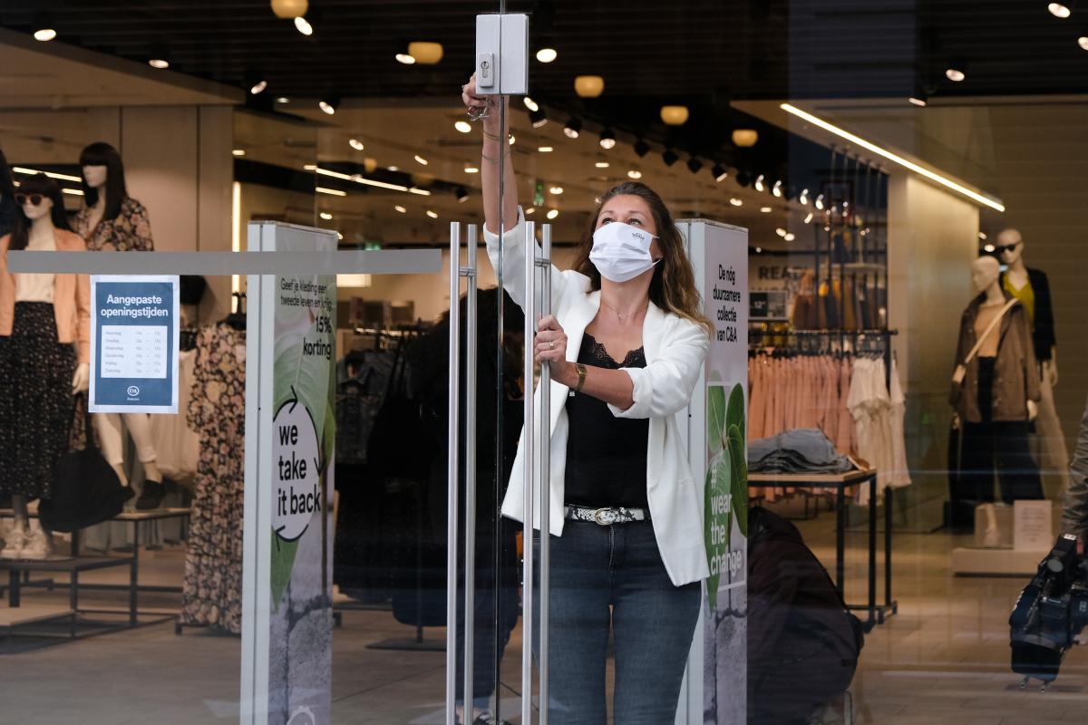 Retail employee opening up store