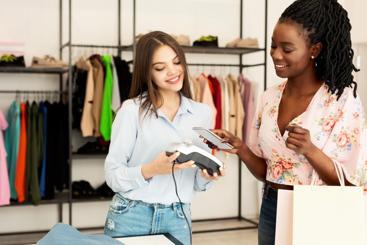 Retail employee serving customer