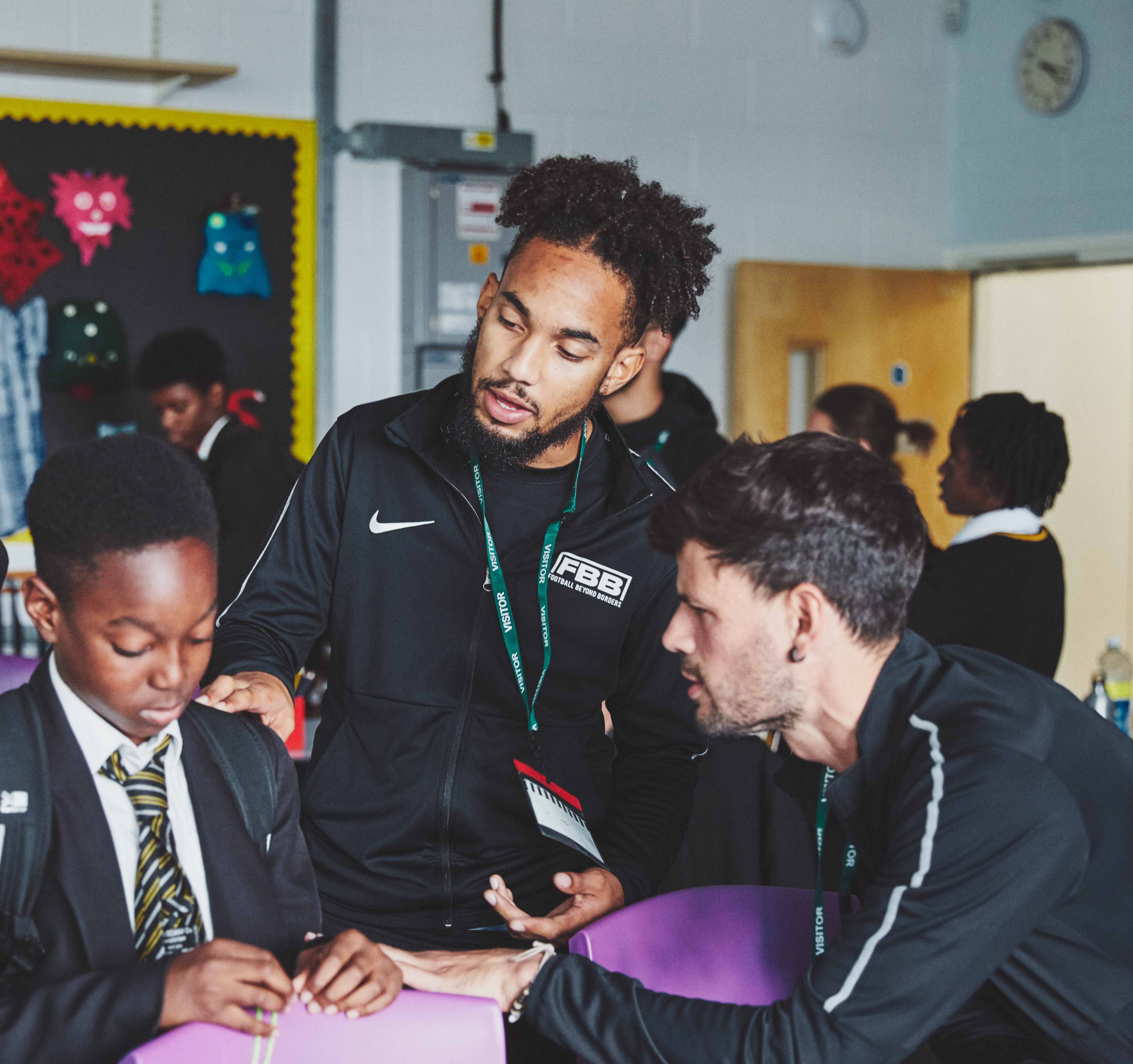 FBB practitioner supporting young person in classroom