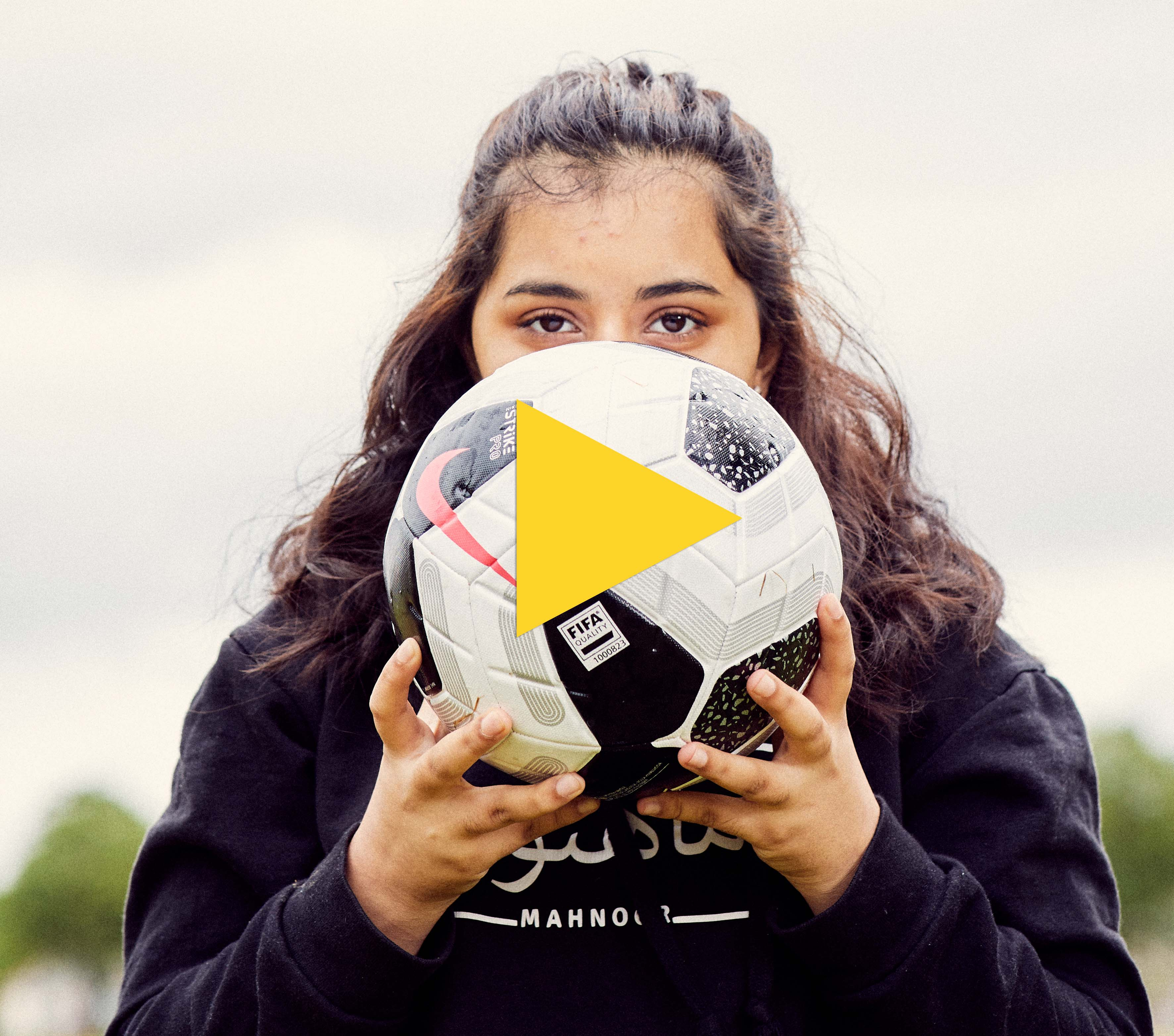 FBB participant holds up football
