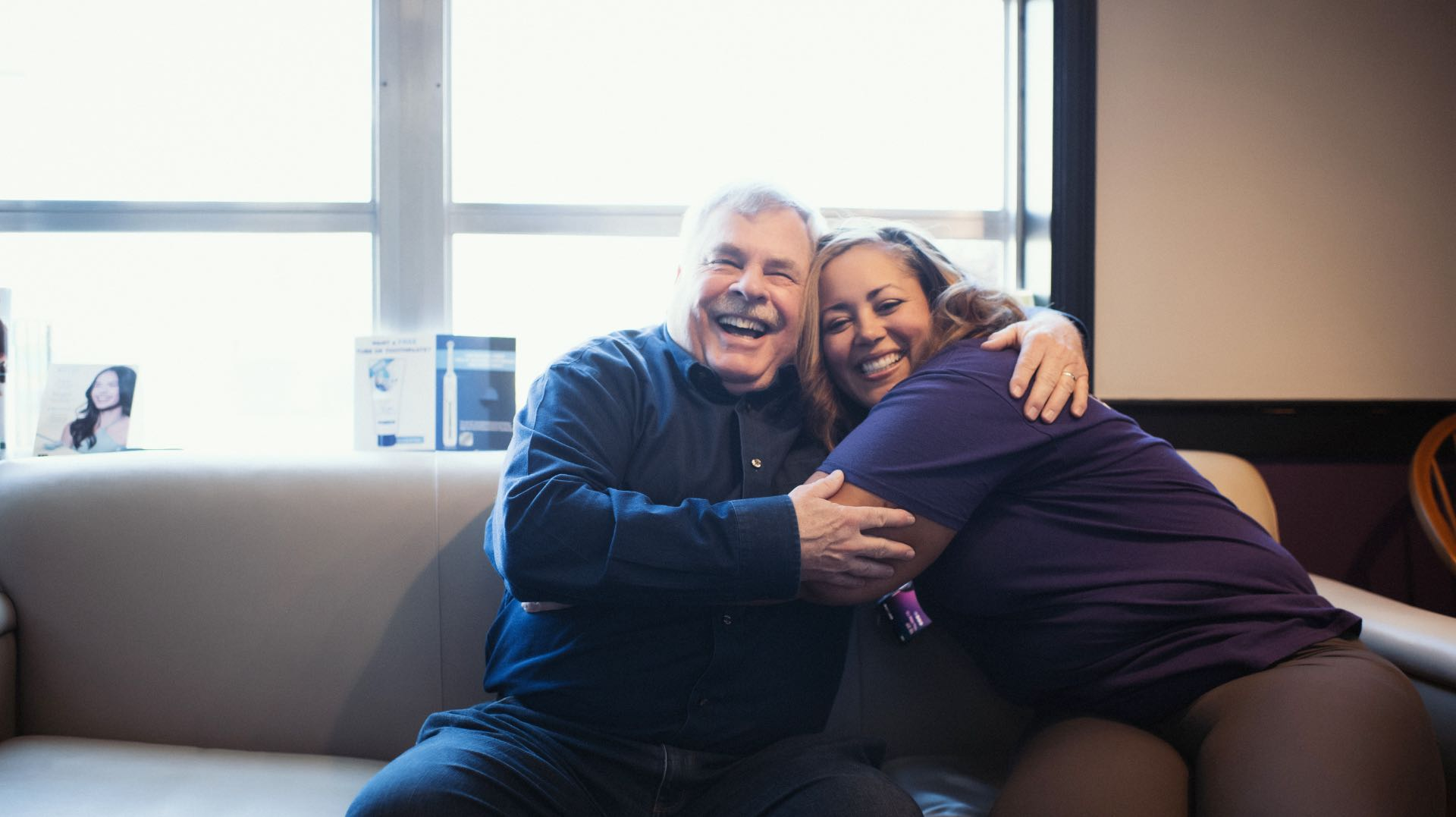 Photo of Dr. Moore and a patient smiling and hugging
