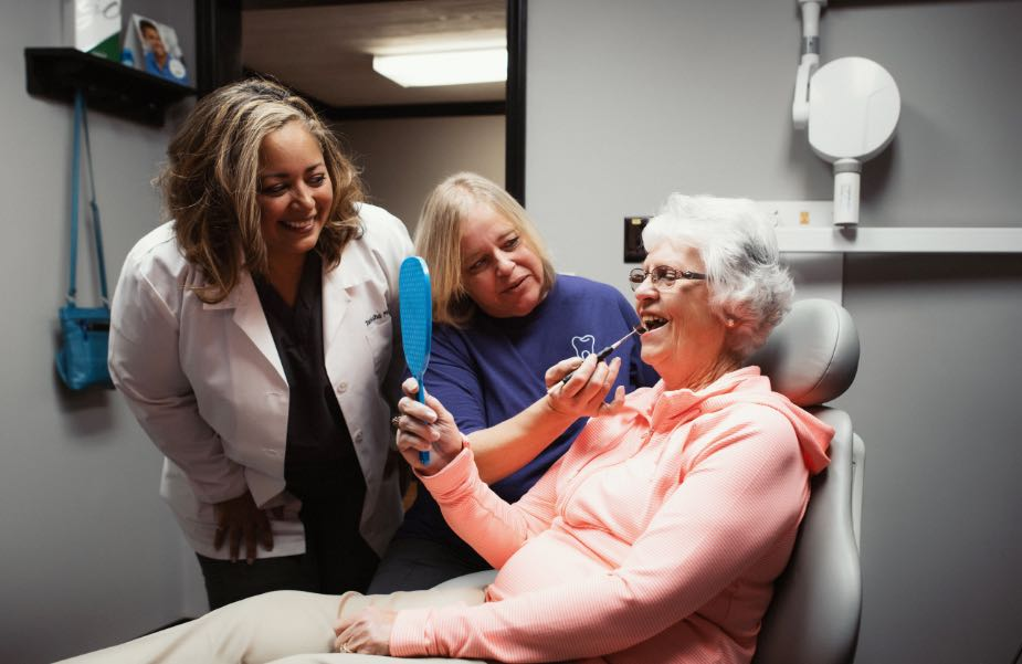 Photo of a patient in the dental chair receiving care