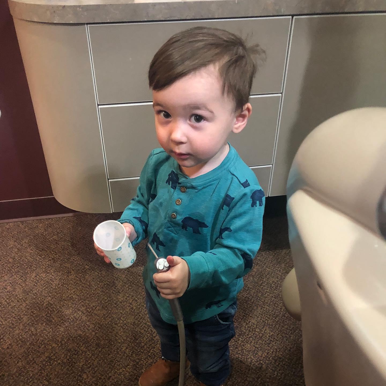 small child getting dental treatment