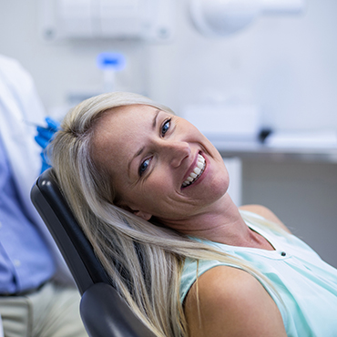 smiling patient in a dental chair