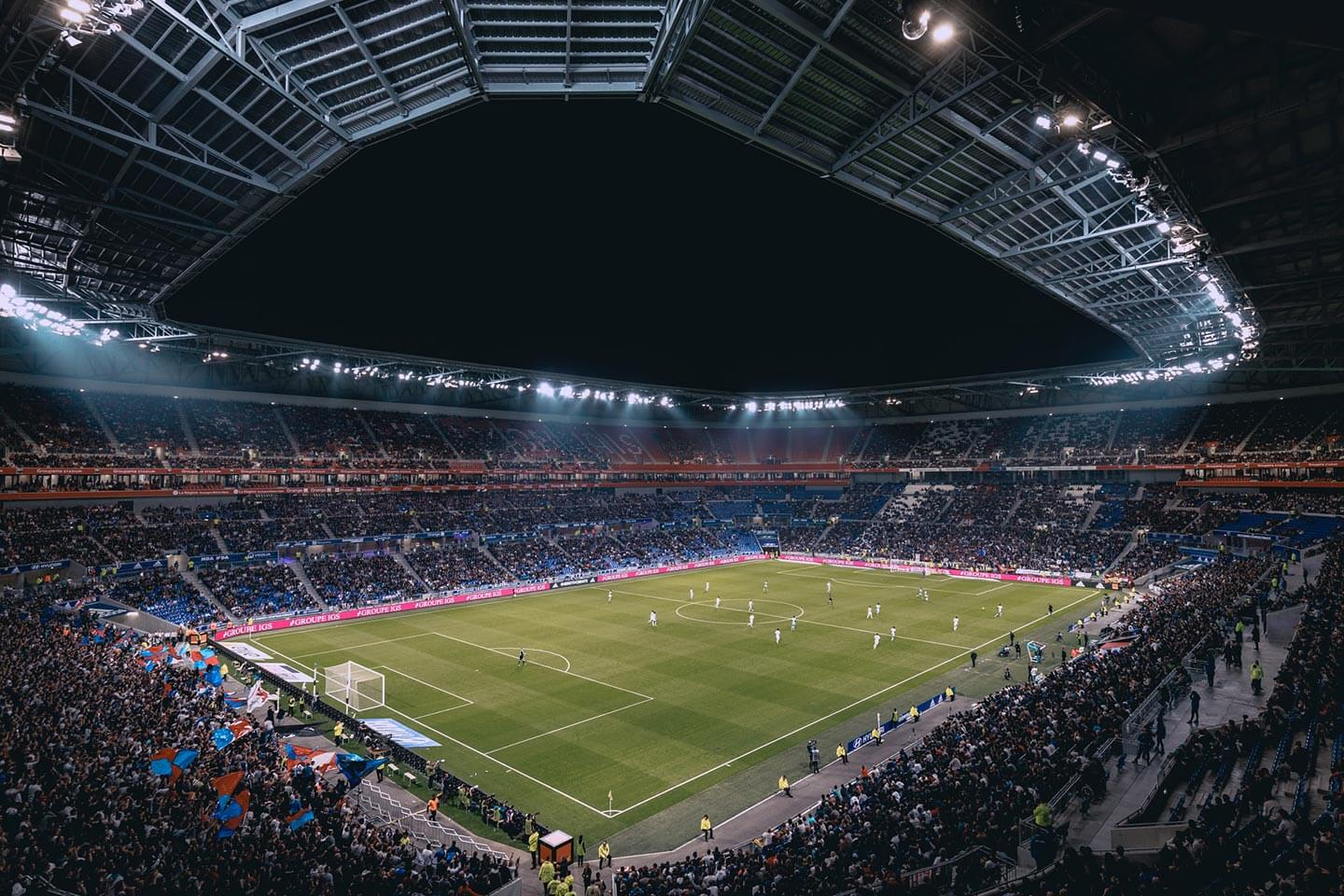 A panorama of a football stadium full of fans